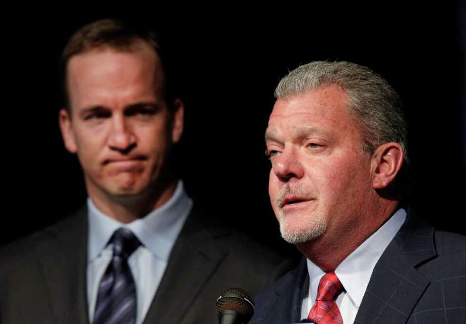 Quarterback Peyton Manning, left, listens as Indianapolis Colts owner Jim Irsay announces that the NFL football team will release him during a news conference in Indianapolis, Wednesday, March 7, 2012. Photo: AP
