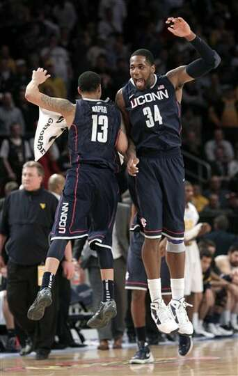 Connecticut's Shabazz Napier, left, and Alex Oriakhi celebrate their win over West Virginia durin