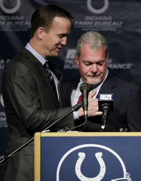 Indianapolis Colts owner Jim Irsay, right, hugs quarterback Peyton Manning after announcing that the NFL football team will release Manning during a news conference in Indianapolis, Wednesday, March 7, 2012..Manning, 35, who missed all of last season after a series of operations on his neck, has been the staring quarterback for 13 season, won a record four MVP's and the 2006 Super Bowl. Photo: AP