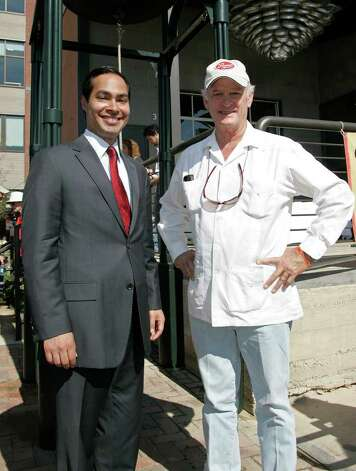 FEATURES; ACS TRENDS CIA JMS; 10/09/10; From the left, Mayor Julian Castro and Kit Goldsbury of Silver Ventures in front of the mission bell at the Grand Opening of the Culinary Institute of America, Saturday, October 9, 2010 at the Pearl Brewery in San Antonio.  ( PHOTO BY J. Michael Short / SPECIAL ) Photo: J. MICHAEL SHORT, SPECIAL TO THE EXPRESS-NEWS / THE SAN ANTONIO EXPRESS-NEWS