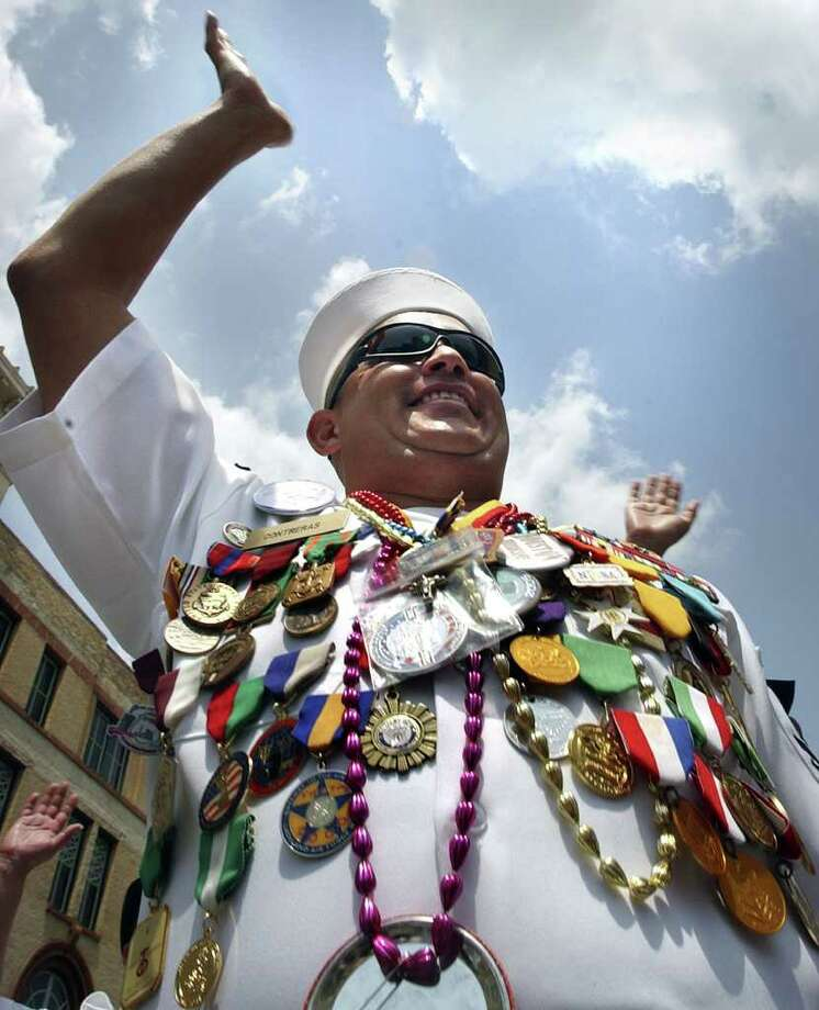 ...you wear half your body weight in medals during Fiesta. --Thad W. Ziegler Photo: Bob Owen, SAN ANTONIO EXPRESS-NEWS / SAN ANTONIO EXPRESS-NEWS