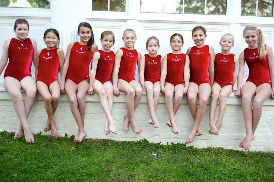 "The Riverside-based US Academy of Gymnastics team had a strong showing at their first meet of the season. Team members include, from left, Sutton Mock, Nika Sibley, Stephanie Browder, Sophia Bastek, Jackie Braselton, Mikaela Patino, Charlotte ""Coco"" Ozizmir, Rachel Korzendorfer, Marjorie Plants and Alice Pehrson. Not pictured are Celeste Diaz, Astrid Rydevik, Klara Svedin and Eliza Dow. Photo: Contributed Photo / Greenwich Citizen"