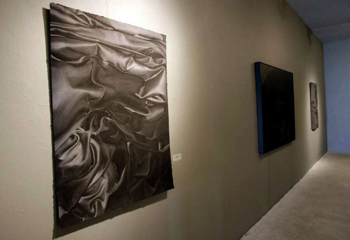 SA LIFE: Vikky Jones is presenting her MFA thesis exhibition as part of Contemporary Art Month. Her monochromatic paintings and drawings of objects such as wet fabric and a tea set floating in a water evoke dreams and the subconscious. Helen L. Montoya/San Antonio Express-News