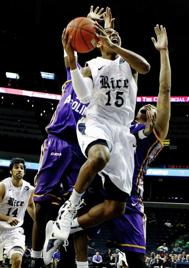 Rice's Julian DeBose (15) drives to the basket past East Carolina defenders during the second half Wednesday in Memphis, Tenn. Photo: Mark Weber, AP / The Commercial Appeal