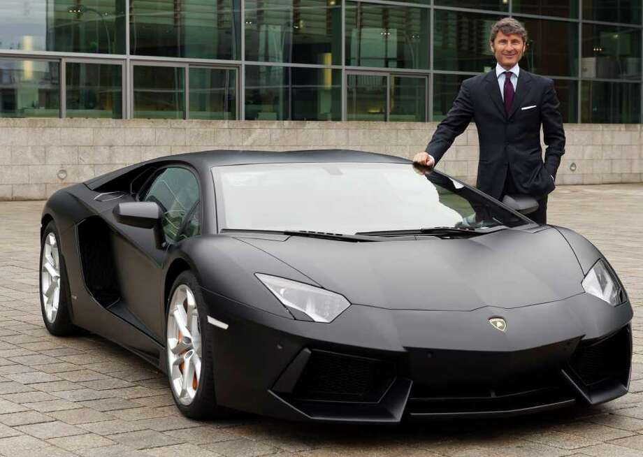 Stephan Winkelmann, chief executive officer of Lamborghini SpA, poses alongside a matt black Lamborghini Aventador LP 700-4 following a news conference in Ingolstadt, Germany, on Thursday, March 1, 2012. Audi AG, the world's second-largest maker of luxury vehicles, is targeting 2012 profit ''on par'' with last year's record results as higher sales offset increased spending on new models and factories. Photographer: Guenter Schiffmann/Bloomberg *** Local Caption *** Stephan Winkelmann Photo: Guenter Schiffmann / © 2012 Bloomberg Finance LP