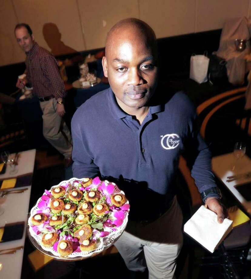 Kelven Scarlett of Cos Cobber restaurant serves homemade crab cakes during the 27th annual Great Chefs event at the Hyatt Regency Greenwich. Photo: Bob Luckey / Greenwich Time