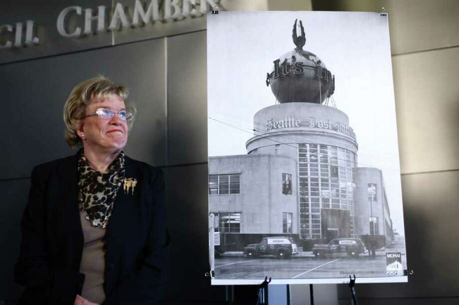 Seattle City Councilmember Jean Godden, a former newspaper columnist, stands next to a photograph of the Seattle P-I globe during a press conference announcing a plan to preserve the local landmark on Wednesday, March 7, 2012 at Seattle City Hall. Photo: JOSHUA TRUJILLO / SEATTLEPI.COM