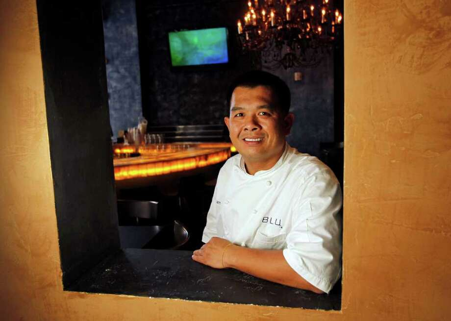 Blu restaurant lounge executive chef Junnajet Hurapan says he doesn't like to be limited to one cuisine. Photo: James Nielsen / © 2011 Houston Chronicle