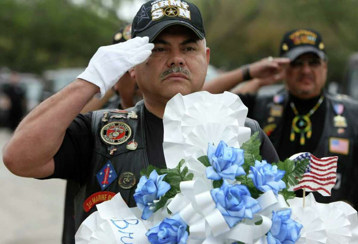Johnnie Puente, with the Brothers of Fallen Heroes, salutes during a memorial service for Albert Lee Renfro and Everardo Alvarez-Lara. The two veterans were given military services through the Dignity Memorial Homeless Veterans Memorial Program on Wednesday, March 8 at Fort Sam Houston National Cemetery. Burials for forgotten veterans are held there and at VA cemeteries elsewhere around the country. Texas also has established four state veterans' cemeteries. The government provides a government headstone or marker, a U.S. burial flag and perpetual care of the gravesite for these veterans buried in a VA cemetery.
