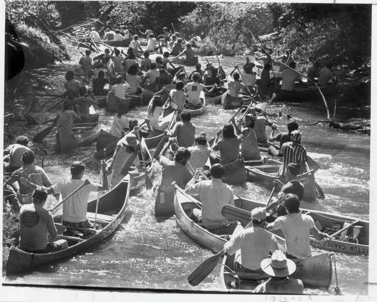 Chronicle file photo by Othell O. Owensby Jr., Chronicle staff SHOT ON APRIL 22, 1972. CANOE RACE DOWN BUFFALO BAYOU. REEKING REGATTA. HOUCHRON CAPTION (06/06/1999): The race is on as dozens of canoers battle one another and the bayou in one of the first ``Reeking Regatta'' events in 1971. The bayou was more polluted back then, and the race has since been renamed the ``anything-that-floats'' event.