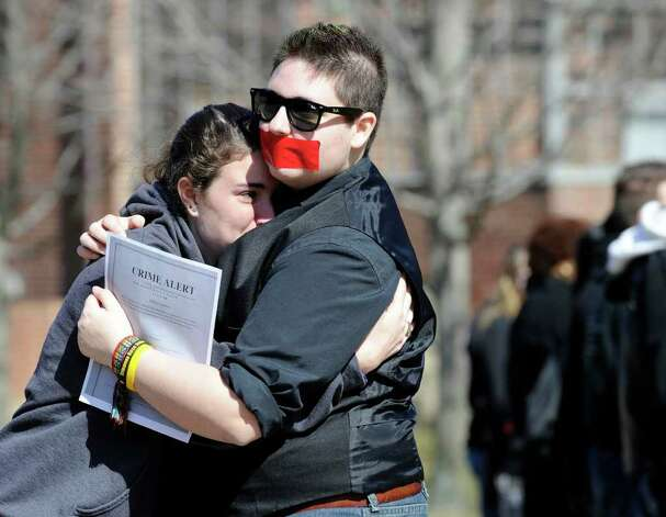 "Western Connecticut State University's Gay Straight Alliance holds a silent protest Wednesday, March 7, 2012, in response to recent hate crimes directed toward students within the gay community at the school. A student had reported that someone had written ""Die dyke"" on an erasable dryboard on campus. Photo: Carol Kaliff / The News-Times"