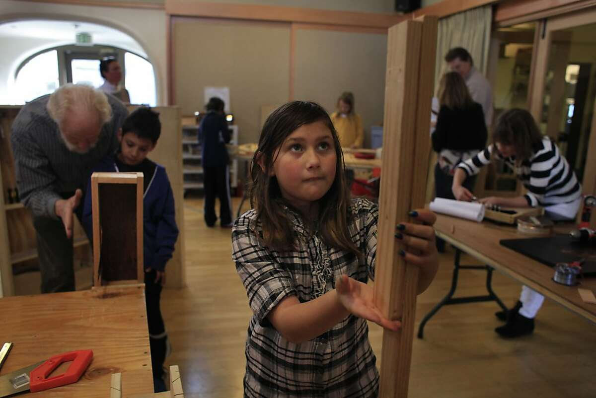 Marissa Burke, 9, lines up boards she will saw to make a slit drum during the musical instrument building class at The Berkeley School on Wednesday, February 29, 2012 in Berkeley, Calif.