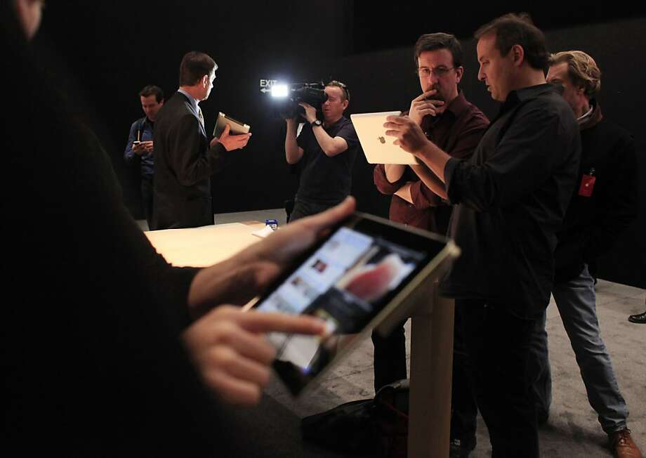 Members of the media preview the new iPad during an Apple event at  The Forum at Yerba Buena Center for the Arts on Wednesday, March 7, 2012 in San Francisco, Calif. Photo: Lea Suzuki, The Chronicle