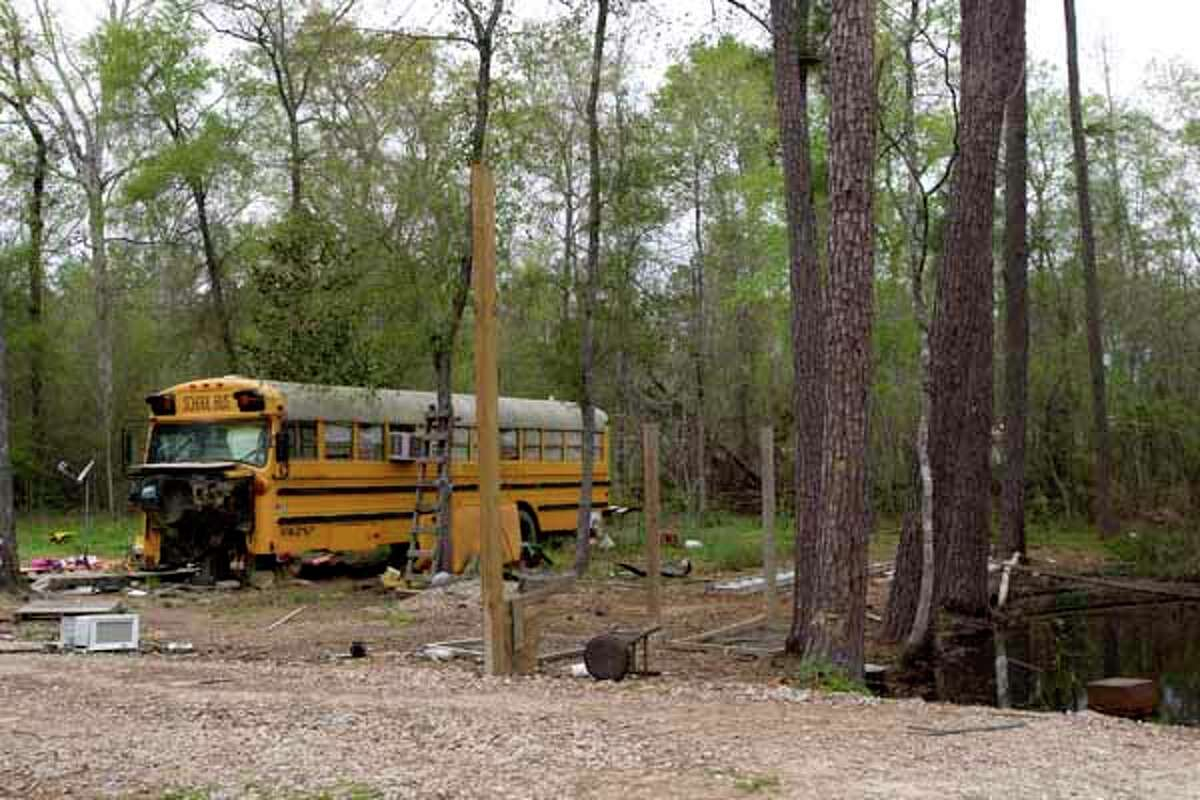 An old school bus is said to be where two young children were found living on Wednesday in Spendora. An 11-year-old girl was found with her 5-year-old brother. Both of the children's parents are in prison, officials said.