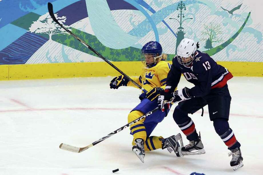 VANCOUVER, BC - FEBRUARY 22: Julie Chu #13 of the United States charges Katarina Timglas #15 of Sweden during the ice hockey women's semifinal game between Sweden and USA on day 11 of the Vancouver 2010 Winter Olympics at Canada Hockey Place on February 22, 2010 in Vancouver, Canada.  (Photo by Cameron Spencer/Getty Images) Photo: Cameron Spencer, ST / 2010 Getty Images