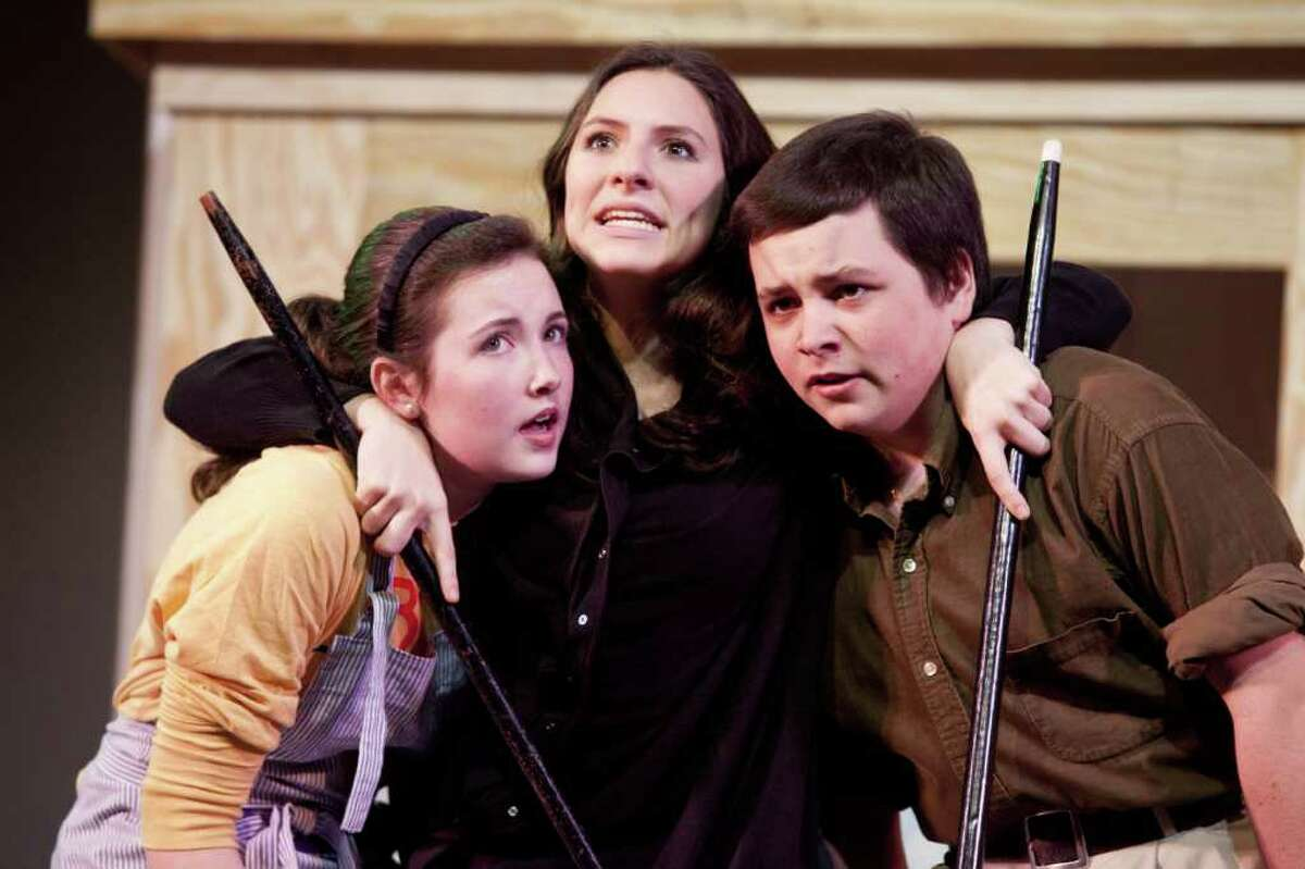"""The Witch (Michelle Pauker), center, has a word with the Baker's Wife (Claire Smith), left, and The Baker (Ryan Shea) in a rehearsal scene of The Staples Players production of """"Into the Woods."""""""