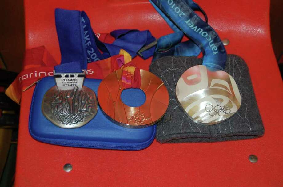 Pictured are Julie Chu's medals, from left, silver from 2002 in Salt Lake City, bronze from 2006 in Torino, Italy and 2010 in Vancouver, British Columbia. Photo: Pat Pickens, ST