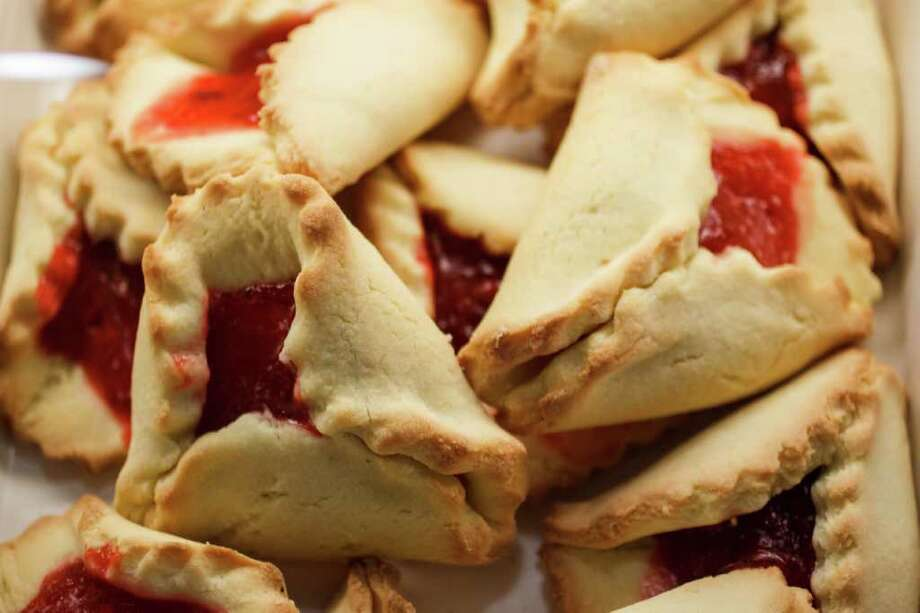 Cherry hamantaschen, triangular pastries traditionally made for the Jewish holiday of Purim, at Three Brothers Bakery. Photo: Michael Paulsen / © 2012 Houston Chronicle