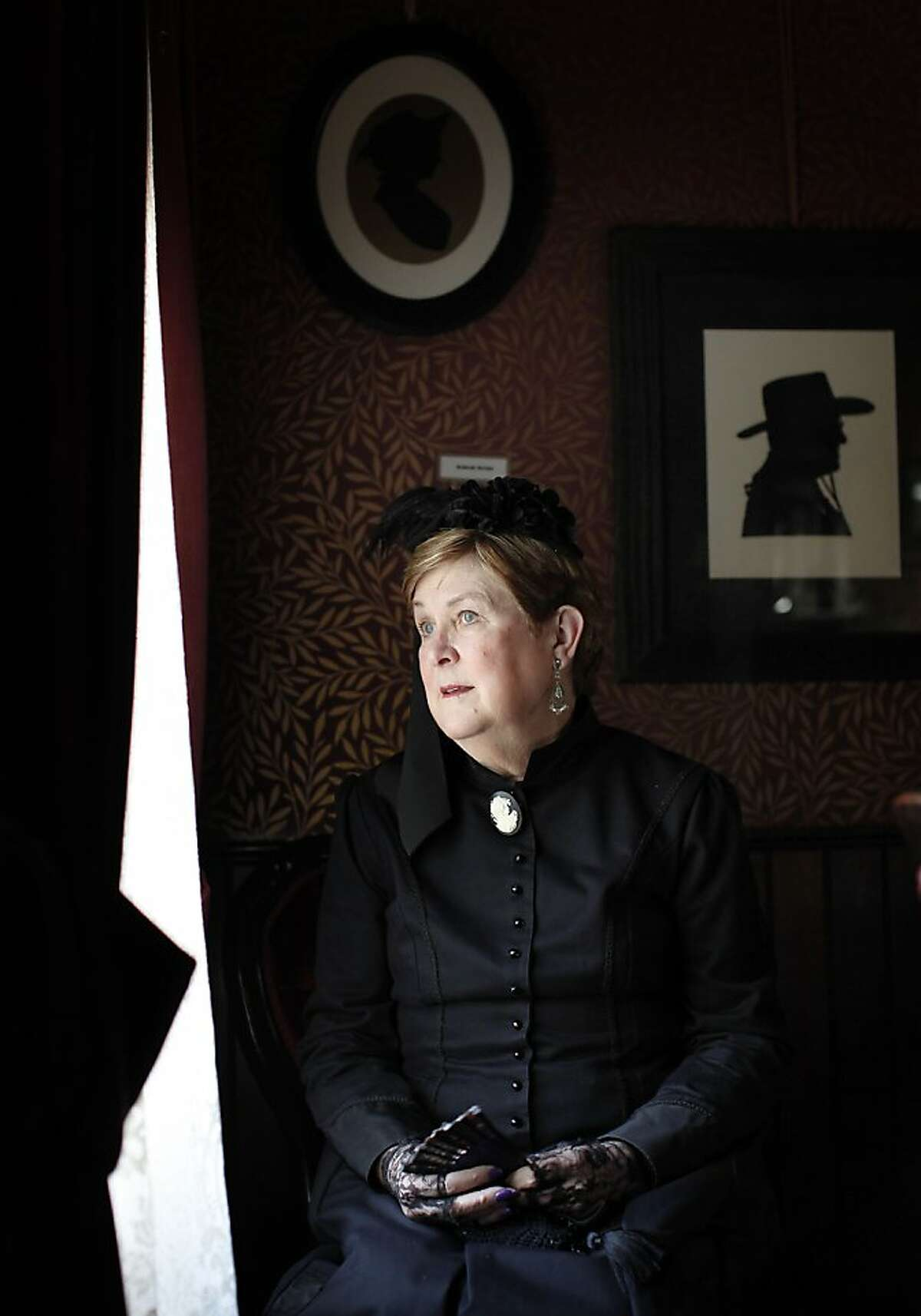 Docent Martha Wallace looks outside Rengstorff House window in Mountain View, Ca on Tuesday, March 6, 2012