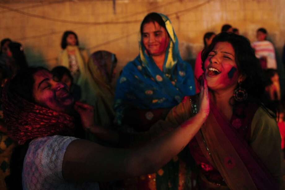 Pakistani Hindu women celebrate Holi festival in Karachi on March 7, 2012. Holi, a Festival of colours and is a popular Hindu spring festival observed at the end of winter season on the last full moon day of the lunar month.   AFP PHOTO/Asif HASSAN (Photo credit should read ASIF HASSAN/AFP/Getty Images) Photo: Asif Hassan, AFP/Getty Images
