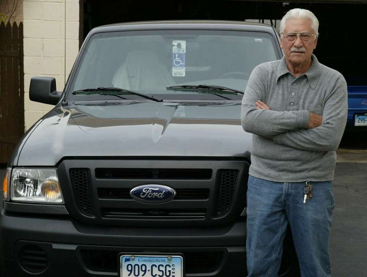 Frank Mondo of Bridgeport with the Ford pick up truck that he bought which was missing some parts,Tuesday, Nov. 10, 2009