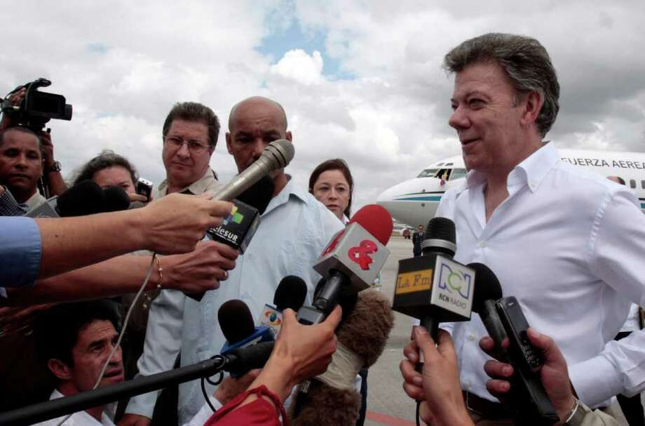 Colombia's President Juan Manuel Santos speaks to reporters upon his arrival at the Jose Marti International Airport, in Havana, Cuba, Wednesday March 7, 2012. Santos flew to Cuba on Wednesday to meet with counterpart Raul Castro about an upcoming regional summit amid talk of a possible boycott that would be a challenge to U.S. foreign policy. Members of the Venezuelan-led leftist Bolivarian Alliance, or ALBA, demanded last month that Cuba be included in the April 14-15 Summit of the Americas in Cartagena, but stopped short of threatening a boycott while urging Colombia to extend an invitation. As host, Colombia gets the final decision. Photo: AP