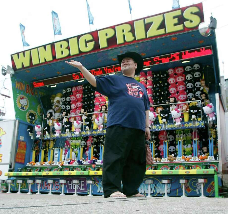 "Japanese Grand Sumo wrestlers Keisuke Kamikawa who competes as ""Waka"" looks over the carnival and midway while during a tour of The Houston Livestock Show & Rodeo. Photo: James Nielsen, Chronicle / © 2011 Houston Chronicle"