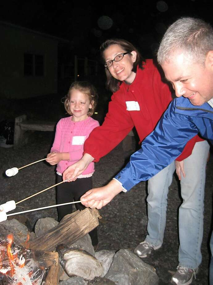 Family members enjoy roasted marshmallows after a NatureBridge night hike in Golden Gate National Recreation Area. Photo: NatureBridge