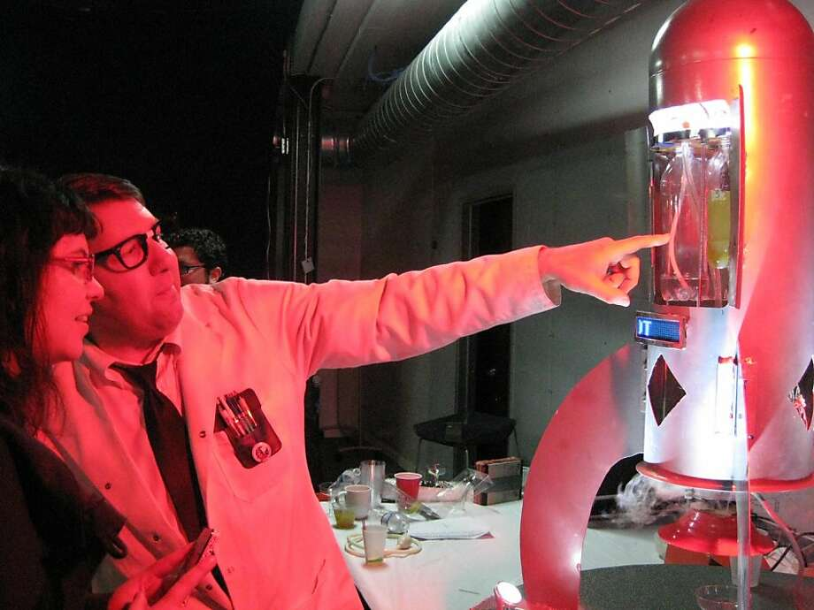 Engineer Ken Mochel with Cosmobot at BarBot 2012 Photo: Kimberly Chun