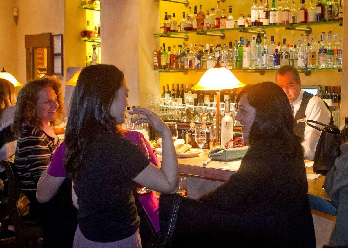 People enjoy happy hour at Kokkari Restaurant in San Francisco Calif., on Thursday, March 1st, 2012.