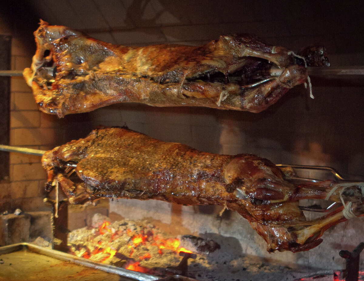 Lamb roasts on the giant rotisserie in the front dining room at Kokkari.
