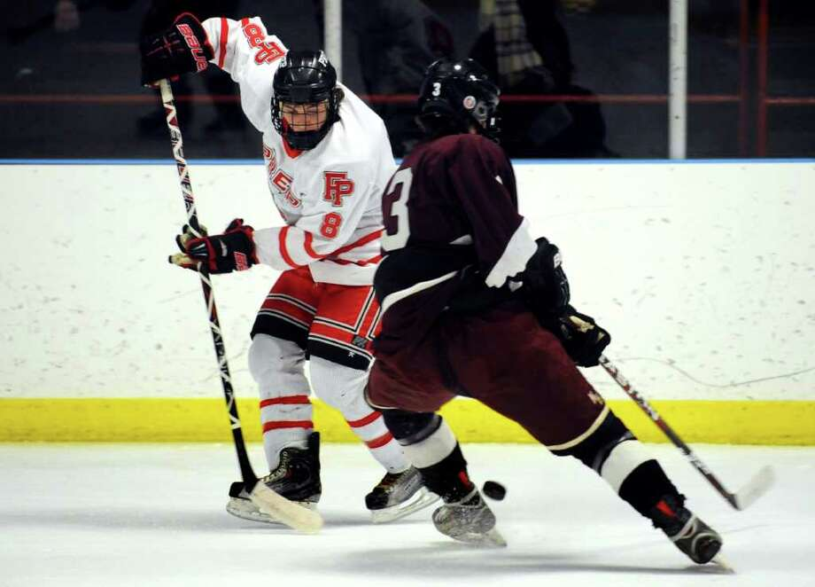 Fairfield Prep's David White and North Haven's Chase Johnson battle for the puck during the Divison I boys hockey tournament first round game Wednesday, Mar. 7, 2012 at Wonderland of Ice in Bridgeport, Conn. Photo: Autumn Driscoll / Connecticut Post