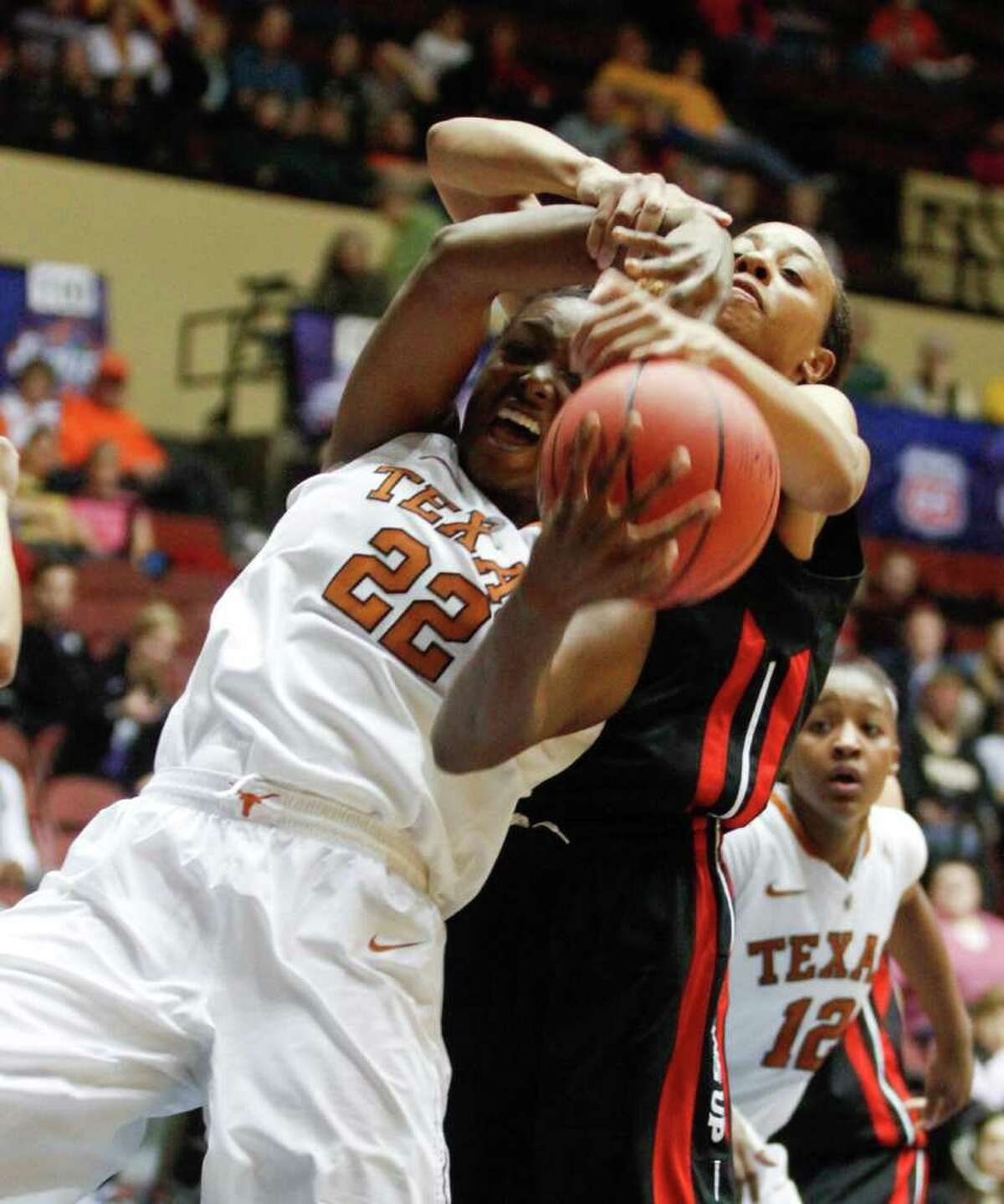 Texas guard Ashley Gayle (22) and Texas Tech guard Ashleigh Fontenette battle for a rebound in the second half of a first-round of the Big 12 Conference championship NCAA college basketball game on Wednesday, March 7, 2012, in Kansas City. (AP Photo/Jeff Tuttle)