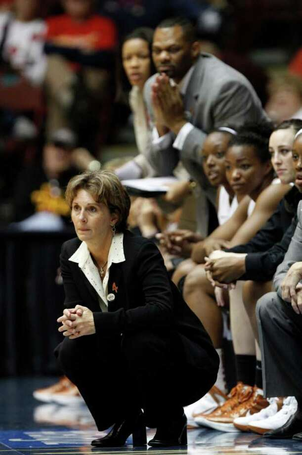Texas head coach Gail Goestenkors watches from the bench in the second half of a first-round of the Big 12 Conference championship NCAA college basketball game against Texas Tech, Wednesday, March 7, 2012, in Kansas City. (AP Photo/Jeff Tuttle) Photo: Jeff Tuttle, Associated Press / FR170439 AP
