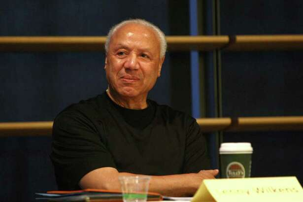 Former NBA player and coach Lenny Wilkens, part of an Arena Review Panel, listens as Chris Hansen speaks before the panel on Wednesday, March 7, 2012 at Seattle City Hall.