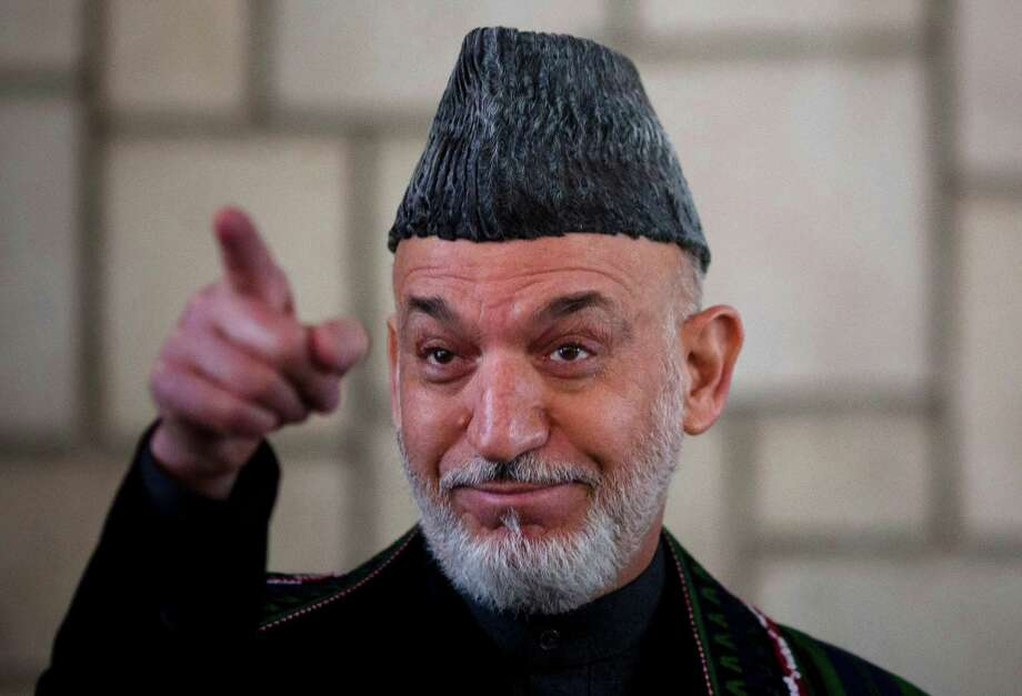 Afghan President Hamid Karzai said he wants the  U.S. to commit to an annual payment of at least $2 billion a year when it  withdraws its troops. Photo: Anja Niedringhaus / AP