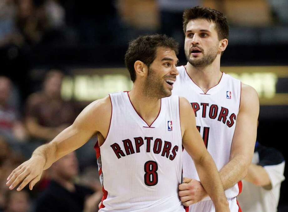 Toronto Raptors guard Jose Calderon (8) laughs with teammate Linas Kleiza, right, during the second half of an NBA basketball game against the Houston Rockets on Wednesday, March 7, 2012, in Toronto. (AP Photo/The Canadian Press, Nathan Denette) Photo: Nathan Denette, Associated Press / The Canadian Press