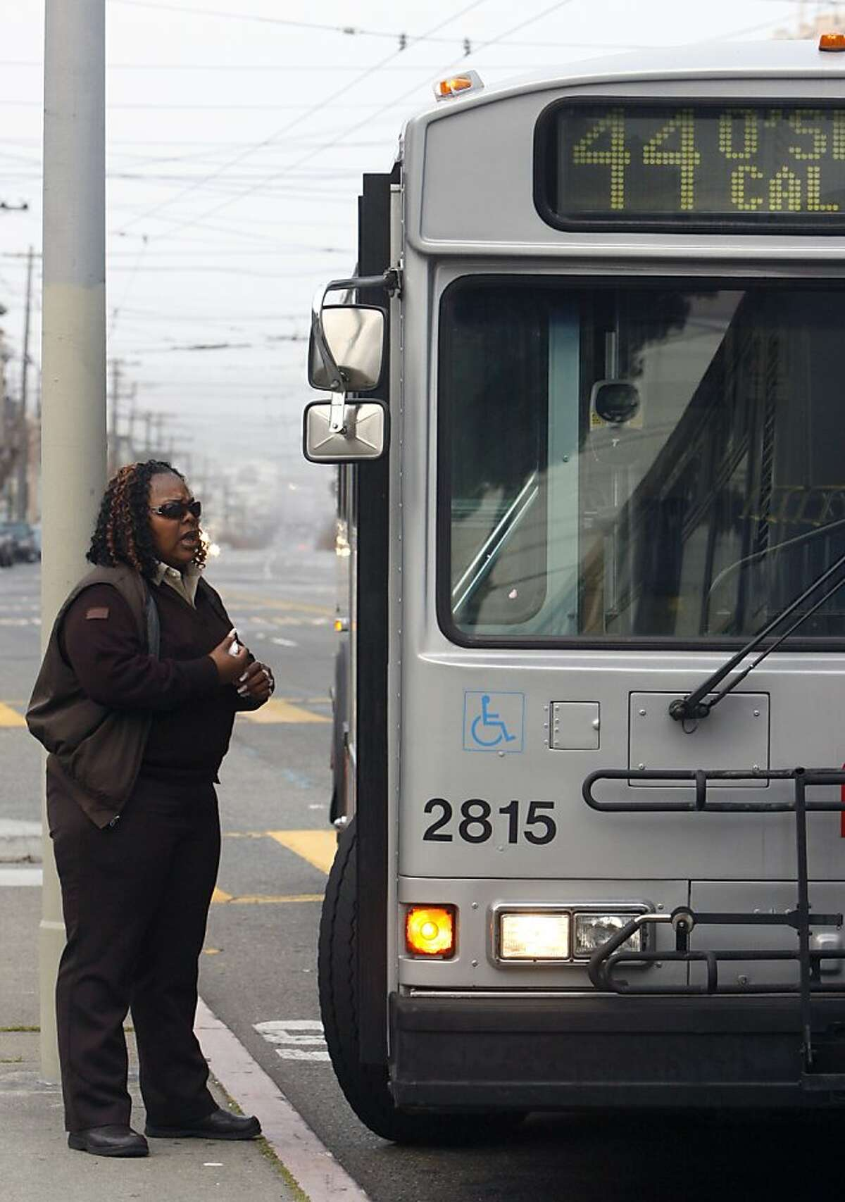 Rochelle Fuller talks with the driver of another 44-O'Shaughnessy Muni bus before making the inbound trip from the Richmond district in San Francisco, Calif. on Friday, Feb. 15, 2008. Photo by Paul Chinn/San Francisco Chronicle