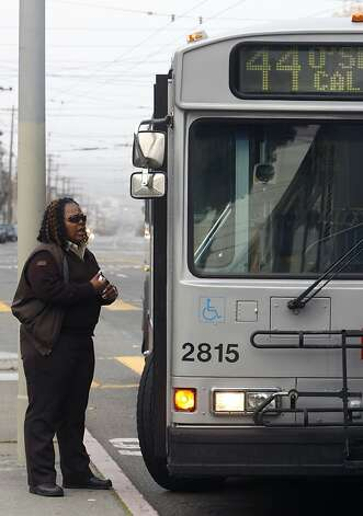 Rochelle Fuller talks with the driver of another 44-O'Shaughnessy Muni bus before making the inbound trip from the Richmond district in San Francisco, Calif. on Friday, Feb. 15, 2008. Photo by Paul Chinn/San Francisco Chronicle Photo: Paul Chinn, SFC