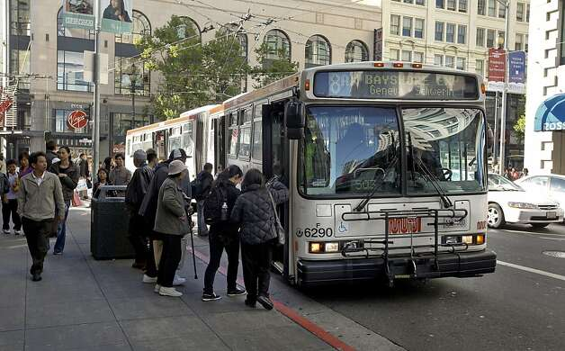 A 8 Bayshore Express bus picks up passengers on the corner of 4th and Market  Streets on Wednesday May, 12, 2010, in San Francisco, Calif. How the $5 million of cuts to MUNI service feels like to the average rider. Photo: Michael Macor, The Chronicle