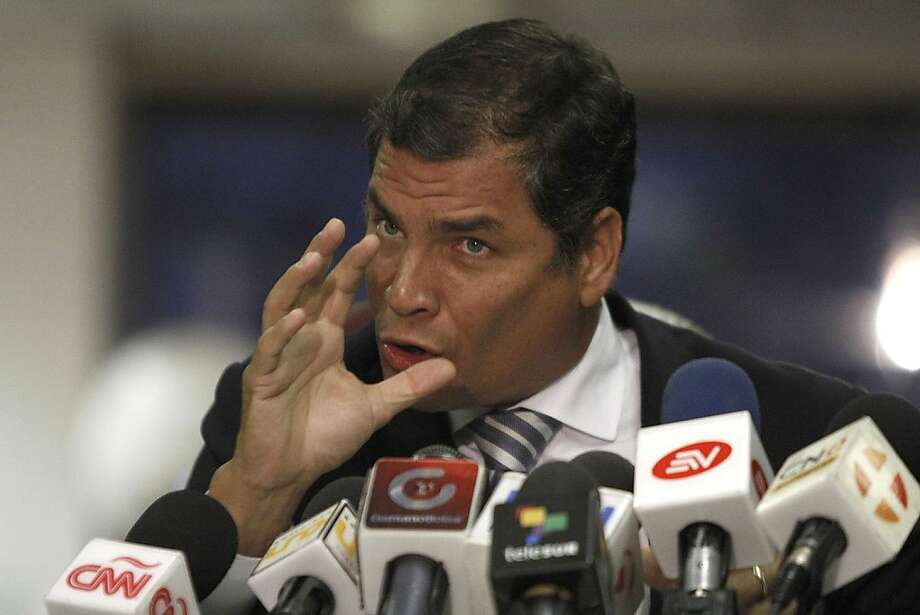 "Ecuadorean President Rafael Correa speaks during a press conference concerning the law suit he presented against the El Universo newspaper for slander in Quito on February 15, 2012. Correa said that if this case is a success, ""it will unchain similar cases in Ecuador and around Latin America. It will be a great step towards the liberation of our America from one of the greatest and most inmune powers, as has been the corrupt press."" AFP PHOTO/Pablo Cozzaglio    (Photo credit should read PABLO COZZAGLIO/AFP/Getty Images) Photo: Pablo Cozzaglio, AFP/Getty Images"