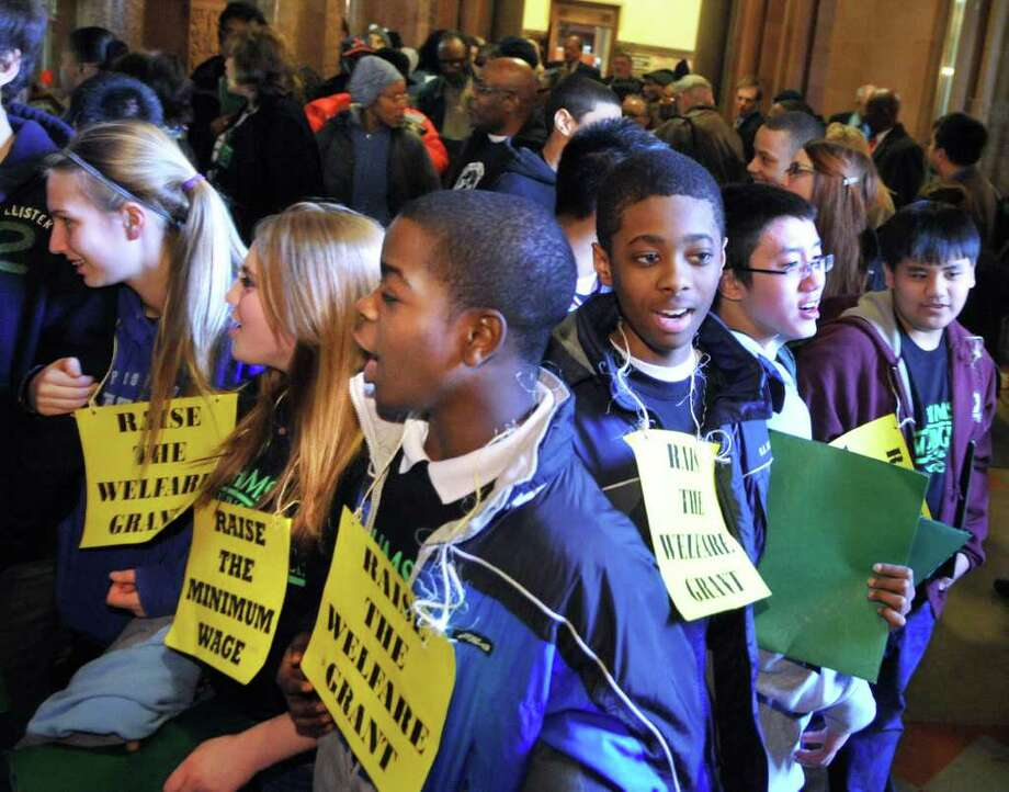 Students from Hackett Middle School join Members of the Hunger Action Network, Empire State Economic Security Campaign, Growing TogetherNY, faith-based organizations and housing advocates to protest inequality during Lobby Day at the Capitol Wednesday March 7, 2012.  (John Carl D'Annibale / Times Union) Photo: John Carl D'Annibale / 00016717A