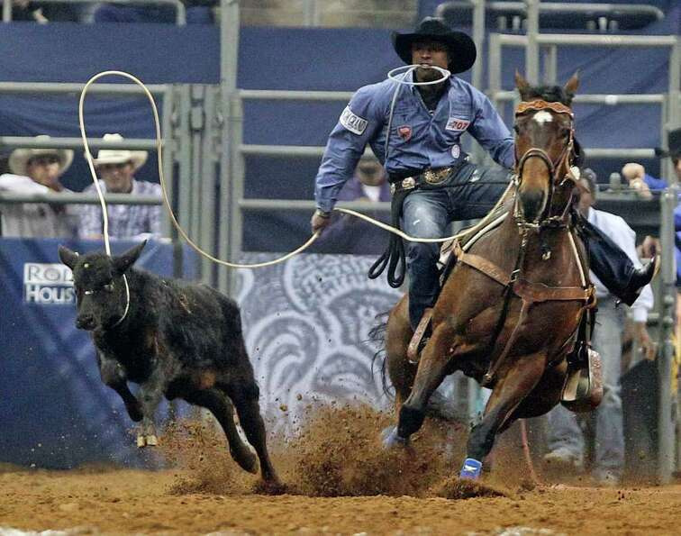 Cory Solomon competes during Tie-Down Roping event Houston Livestock Show and Rodeo at Reliant Stadi