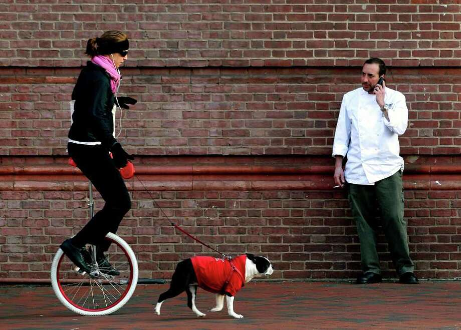 "Here are the top 10 most walkable cities and their Walk Scores, starting with No. 10. Baltimore, which scored 66.2. Walk Score wrote: ""a modern harbor city with American Revolution roots, (Baltimore) is a success story in revitalization. ... Extensive transit connects the city to Reagan National Airport and Washington, D.C. Baltimore's Inner Harbor is where many of the tourist attractions are; Little Italy is one of the country's largest Italian enclaves. Each neighborhood has character and local pride."" Photo: Patrick Semansky, Associated Press / AP"