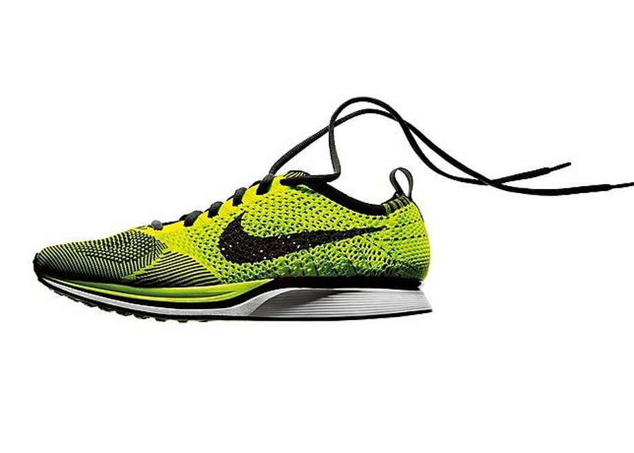 Nike Inc.'s Flyknit, a 5.6-ounce running shoe made from synthetic yarn woven together by a knitting machine, is seen in this undated handout photo, provided to the media on Wednesday, March 8, 2012. Nike's latest running shoe got its start when designers tried to solve a longstanding request from athletes: make shoes as comfortable as socks. Source: Nike Inc. via Bloomberg EDITOR'S NOTE: EDITORIAL USE ONLY. NO SALES. Nike Inc.'s Flyknit, a 5.6-ounce running shoe made from synthetic yarn woven together by a knitting machine, is seen in this undated handout photo, provided to the media on Wednesday, March 8, 2012. Nike's latest running shoe got its start when designers tried to solve a longstanding request from athletes: make shoes as comfortable as socks. Source: Nike Inc. via Bloomberg EDITOR'S NOTE: EDITORIAL USE ONLY. NO SALES. Photo: Nike