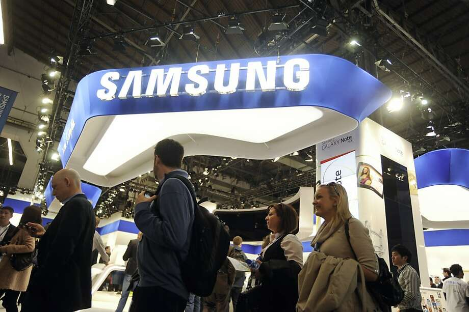 Visitors pass Samsung Electronics Co.'s booth at the Mobile World Congress in Barcelona, Spain, on Monday, Feb. 27, 2012. The Mobile World Congress, operated by the GSMA, expects 60,000 visitors and 1400 companies to attend the four-day technology industry event which runs Feb. 27 through March 1. Photographer: Denis Doyle/Bloomberg Photo: Denis Doyle, Bloomberg