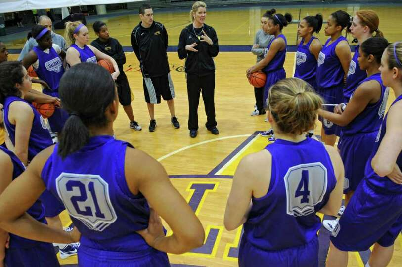 UAlbany women's basketball coach Katie Abrahamson-Henderson talks  to her team at practice as they p