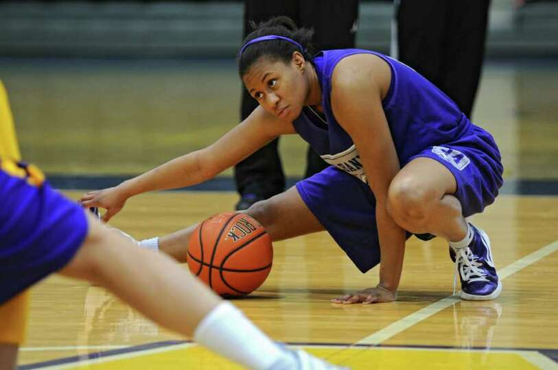 UAlbany women's basketball player Adrienne Jones stretches during practice as her team prepares for