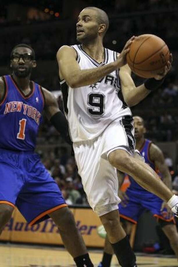 Spurs guard Tony Parker drives by the Knicks' Amar'e Stoudemire during the second half at the AT&T Center, Wednesday, March 7, 2012. The Spurs won 118-105. Jerry Lara/San Antonio Express-News (Jerry Lara / San Antonio Express-News)
