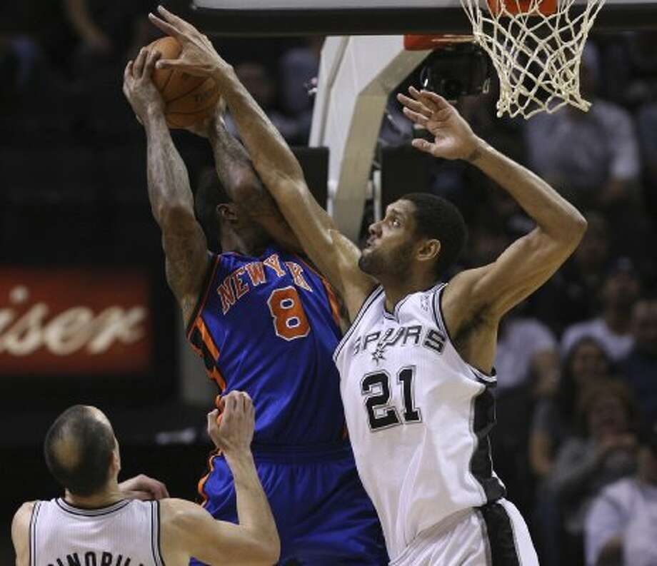 SPURS -- San Antonio Surs Tim Duncan stuffed New York Knicks J.R. Smith late in the fourth quarter at the AT&T Center, Wednesday, March 7, 2012. The Spurs won 118-105. Jerry Lara/San Antonio Express-News (Jerry Lara / San Antonio Express-News)